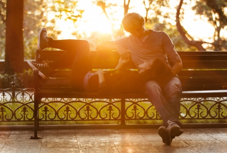 Young couple on the bench at the street. Stock Photo - 14065002