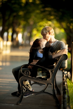 Young couple on the bench at the street. photo