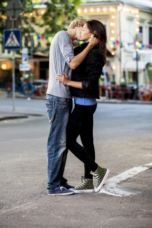 love kiss: Young couple kissing on the street