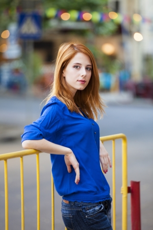 Style redhead girl at the street  photo