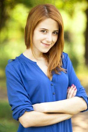 Redhead girl at outdoor. Imagens