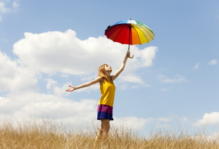 Girl with umbrella at meadow.  photo