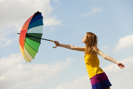 Girl with umbrella at sky background. photo