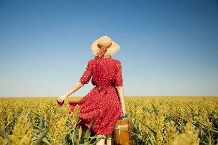 Redhead girl with suitcase at corn field. Stock Photo - 14545099