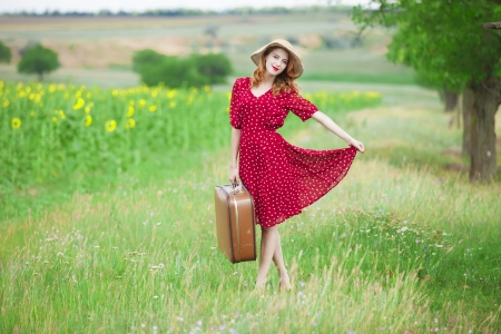 Redhead girl with suitcase at outdoor. photo