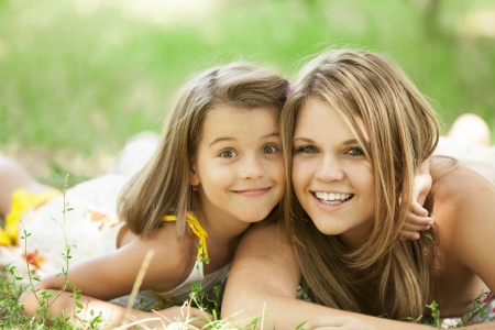 the opposite: Two sisters in the park. Stock Photo