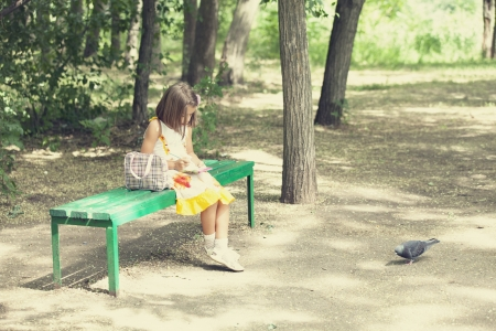Child sit on the bench in the park. photo