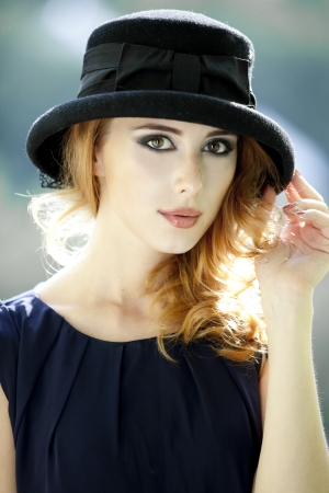 Fashion redhead girl in cap. photo
