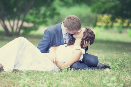 Young couple groom and bride kissing. photo