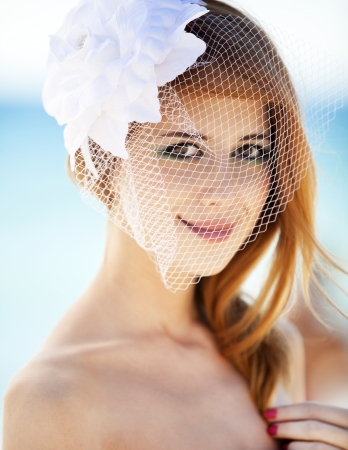 redhead: Young bride at the beach Stock Photo
