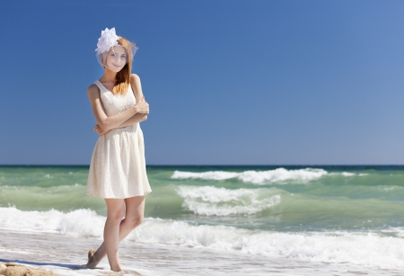 Young bride at the beach photo