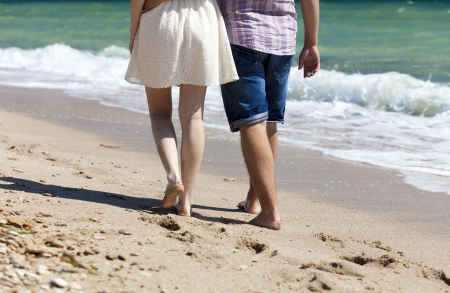 foots: Couple at the beach.