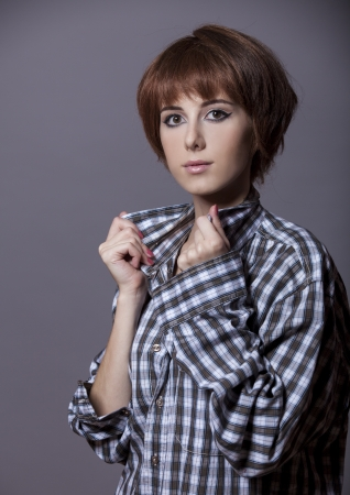 Style girl in shirt at studio. photo