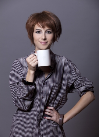 Style girl in shirt with cup at studio. Stock Photo - 15643348