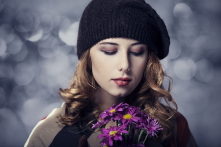Style girl with flowers and bokeh at background. photo