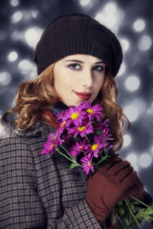 Style girl with flowers and bokeh at background. Stock Photo - 15891573