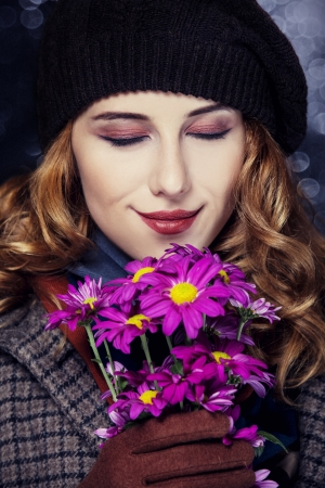 Style girl with flowers and bokeh at background. Stock Photo - 15891581