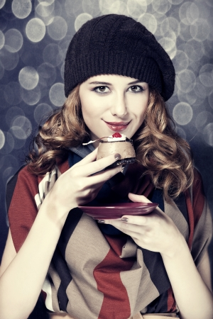 Style girl with cake and bokeh at background. Stock Photo - 15891576