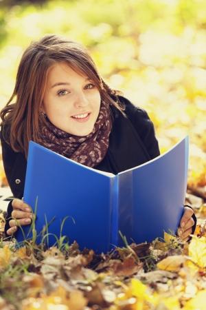 Portrait redhead girl at outdoor. Autumn. Stock Photo - 16009632