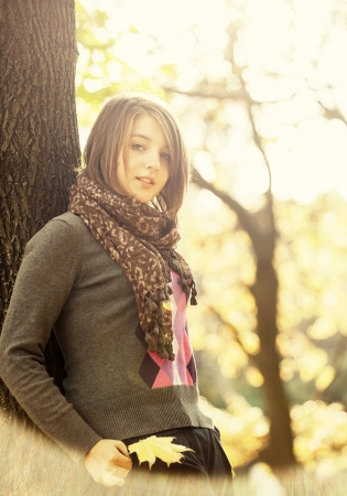 Beautiful girl at autumn park. photo