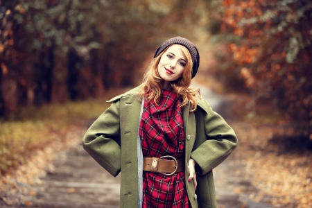 Style redhead girl at beautiful autumn alley. Stock Photo