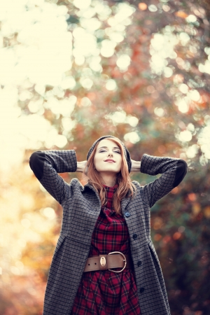 Style redhead girl at beautiful autumn alley. Stock Photo - 16141445