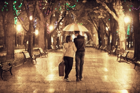 urban urban: Couple walking at alley in night lights. Photo in vintage multicolor style.