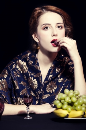 Portrait of beautiful rich women with grapes. Stock Photo - 16304840