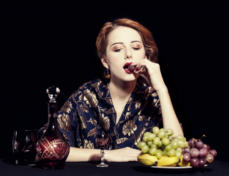 Portrait of beautiful rich women with grapes. Stock Photo - 16304834