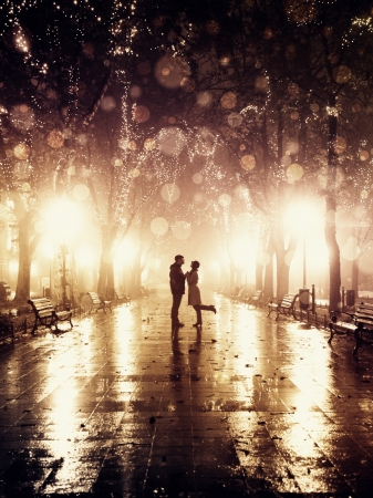city alley: Couple walking at alley in night lights. Photo in vintage style.  Stock Photo