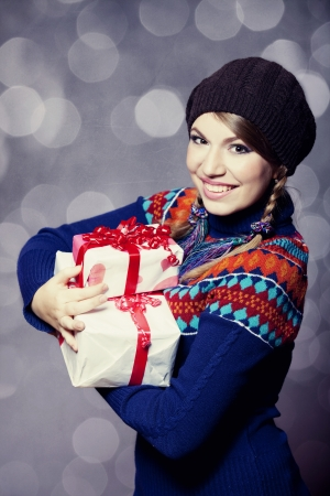 Beautiful girl with gifts photo