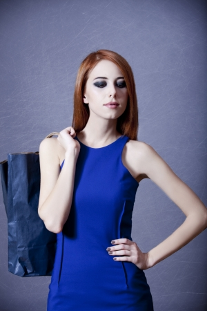 Women in blue dress with bag Stock Photo - 16591888