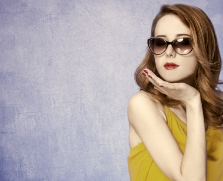 American redhead girl in sunglasses. Photo in 60s style. photo