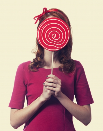Redhead girl with lollipop.  Stock Photo - 16695891