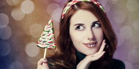 Beautiful women with candy Christmas tree.  photo