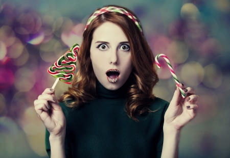 Beautiful women with candy Christmas tree.  Stock Photo - 16761811