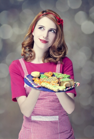 Redhead women with cookies Stock Photo - 17018084