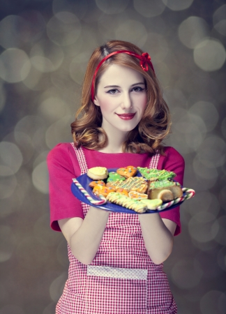 Redhead women with cookies Stock Photo - 17041144