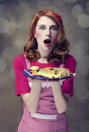 Redhead women with cookies Stock Photo - 17041145