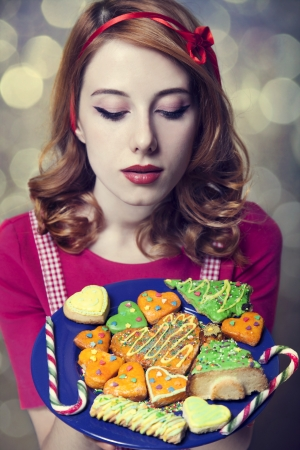 Redhead women with cookies Stock Photo - 17018057
