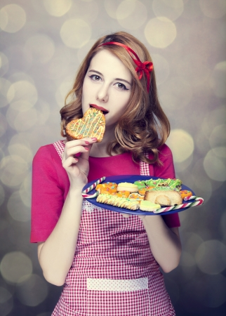 Redhead women with cookies Stock Photo - 17041143
