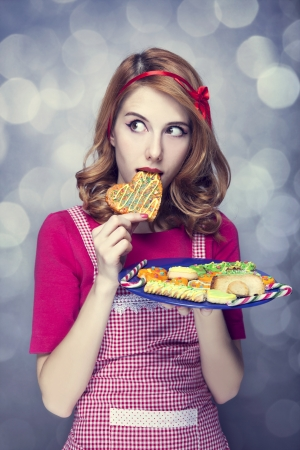 Redhead women with cookies Stock Photo - 17041149