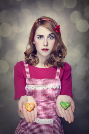 Redhead women with cookies Stock Photo - 17018055