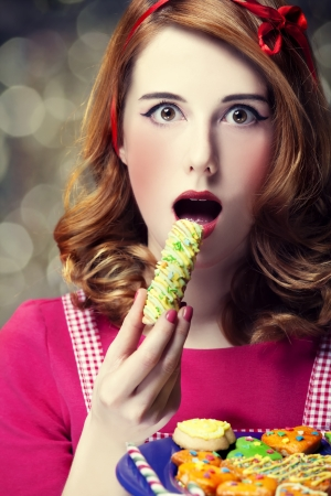 Redhead women with cookies Stock Photo - 17104729