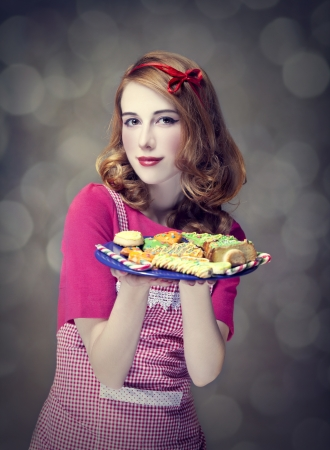 Redhead women with cookies Stock Photo - 17104732
