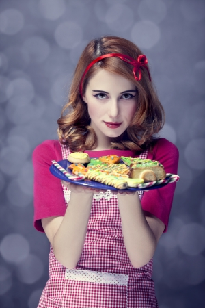 Redhead women with cookies Stock Photo - 17104735