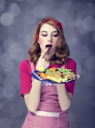Redhead women with cookies Stock Photo - 17104733