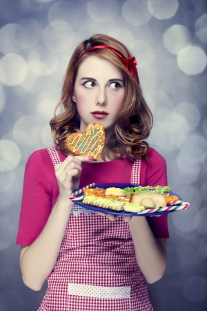 Redhead women with cookies Stock Photo - 17104738