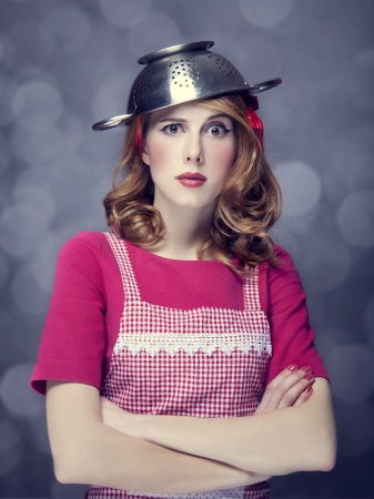 Redhead housewife with colander over head Stock Photo - 17104731