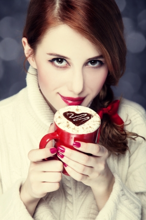 Redhead girl with red coffee cup. St. Valentine Day Stock Photo - 17130144